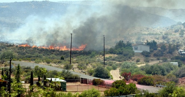 Wind and heat are driving wildfires in the West