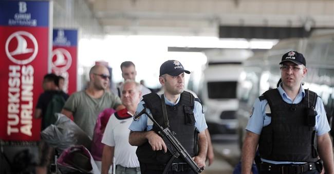 The Latest: Erdogan says Turkey will overcome terror groups
