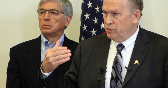 Alaska governor limits annual oil-wealth checks to $1,000