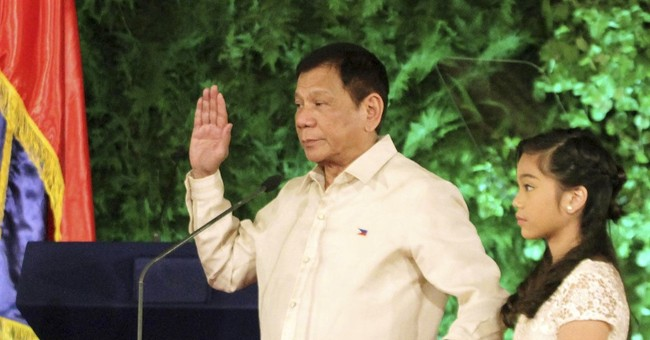 Hope and fear as combative president takes over Philippines