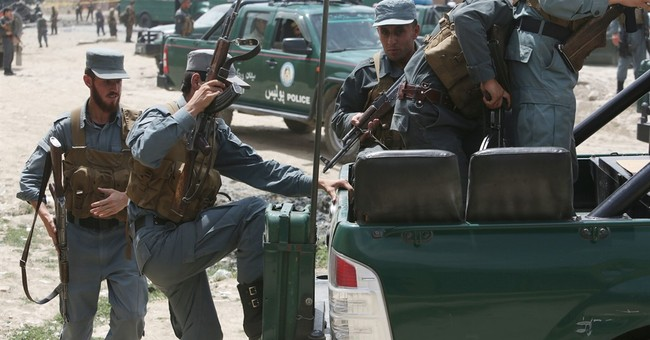 Official: Suicide attack on Afghan police convoy kills 37