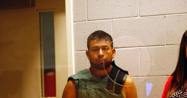 Officials: Man held in Oregon farm shooting deported 6 times