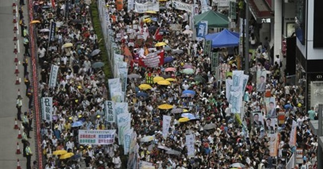 Hong Kong pro-democracy protest draws tens of thousands