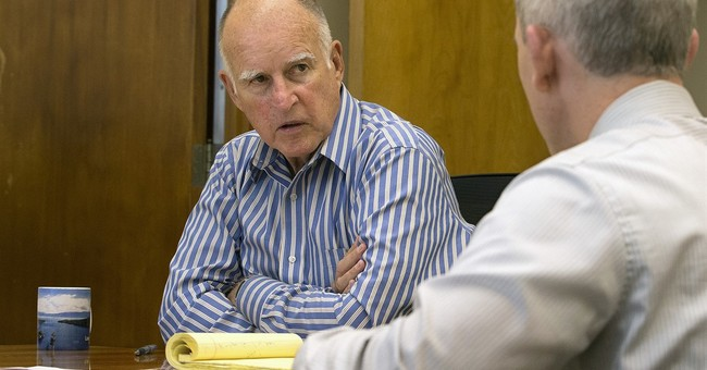 California governor signs stringent gun bills, vetoes others