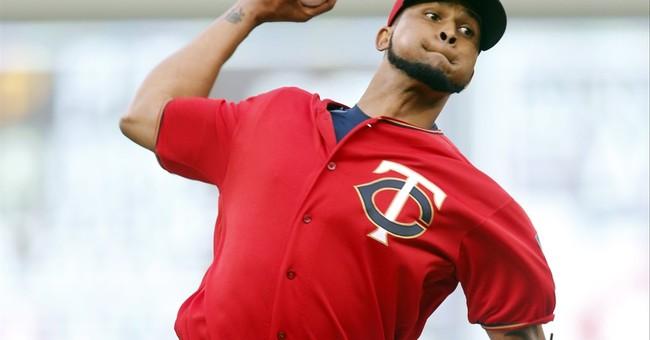 Desmond, Dyson lead Rangers past Twins 3-2 in 10 innings