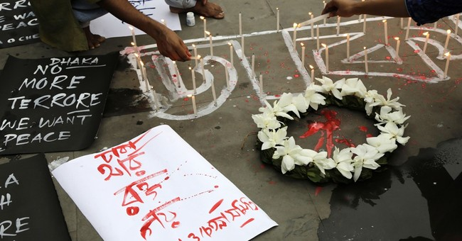 The Latest: Japan to bring victims' kin to Bangladesh