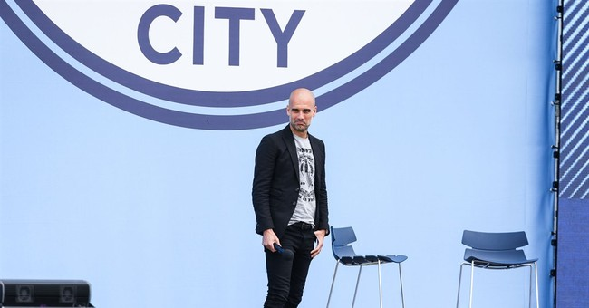 Guardiola cools Messi talk while presented as Man City coach