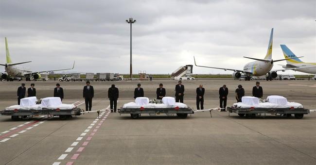 AP PHOTOS: Bodies of 7 Japanese return from Bangladesh