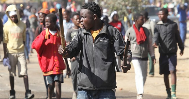 Police battle rioters in Zimbabwe's capital
