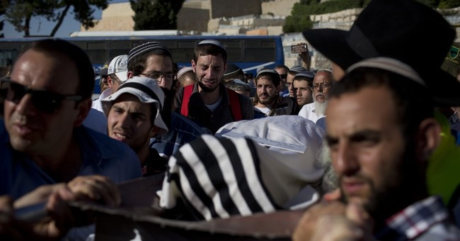 4 Palestinian youths wounded in clash with Israeli troops