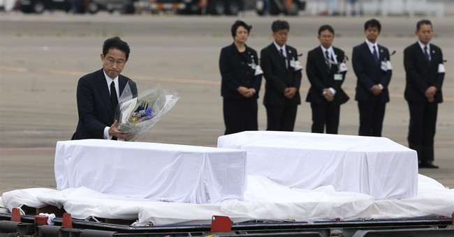 AP PHOTOS: Bodies of 7 Japanese return from Bangladesh