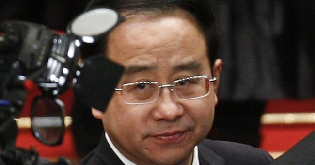 Aide to China's former leader gets life in prison for bribes