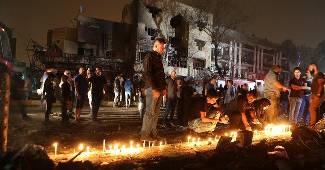 The Latest: Iraq executes 5 a day after bombing