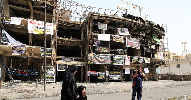 The Latest: Attack on camp for displaced Iraqis kills 3