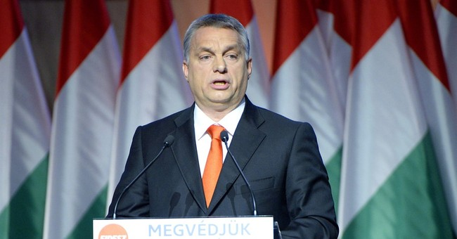 Hungary to hold referendum on EU migrant quotas on Oct. 2