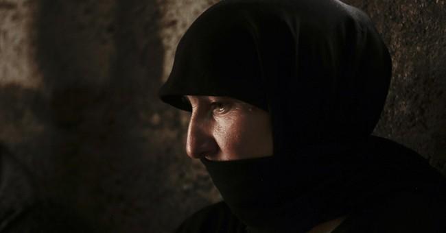 Islamic State tightens grip on women held as sex slaves