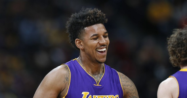 Video shows Lakers' Nick Young holding firework that bursts