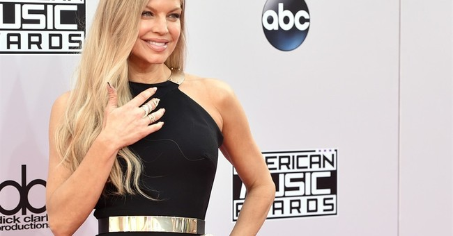 Fergie hopes to empower with song and Kim K-starring video