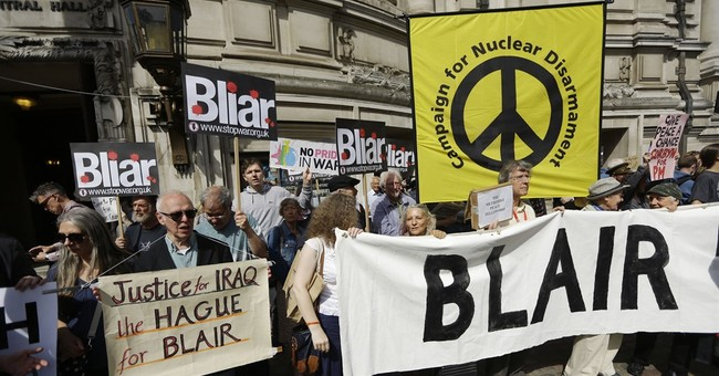 UK report slams Iraq war; Blair says he acted in good faith