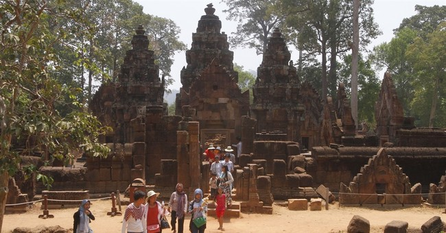 Cambodia says visitors to Angkor temples must dress properly