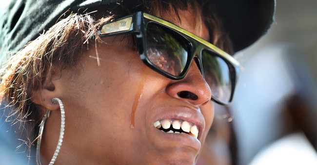 APNewsBreak: Cop's lawyer blames driver's gun, not his race