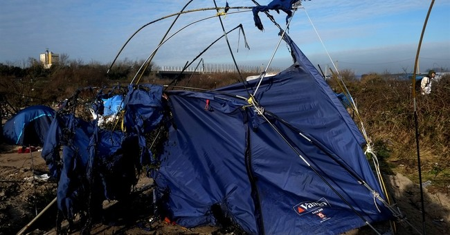 Calais migrants displaced, forced to move deeper into camp