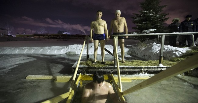 Russians celebrate Epiphany by diving into freezing waters