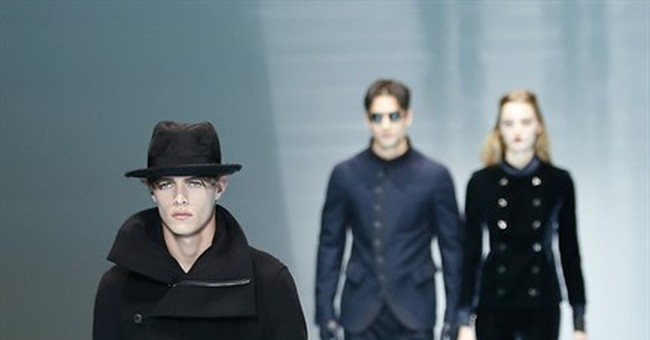 Russell Crowe takes in Giorgio Armani fashion from front row