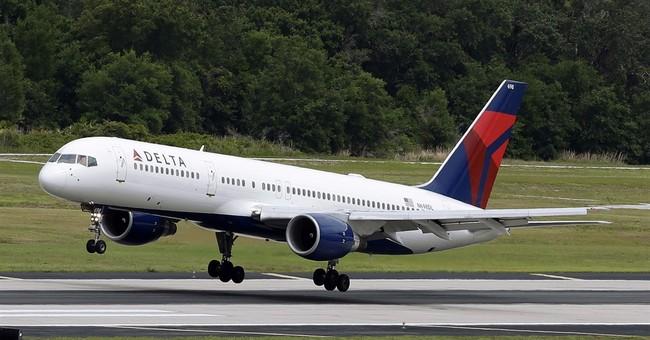 Delta posts $980 million 4Q profit on lower fuel prices