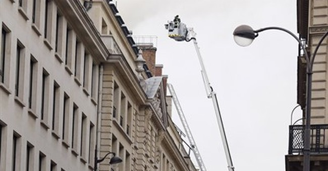 Fire rages on top floor of Paris' Ritz, under renovation