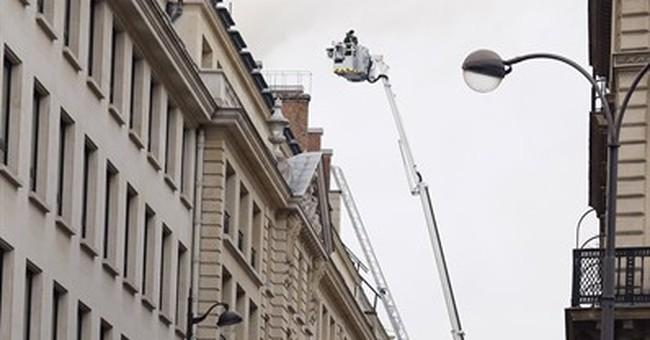 Fire rages on top floor of Paris' Ritz, under renovation