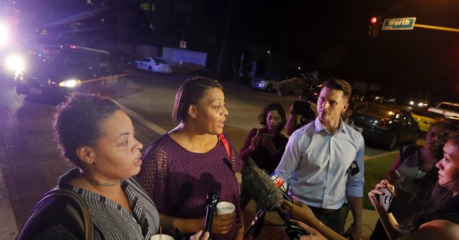 Dallas woman who was shot at protest shielded 4 sons