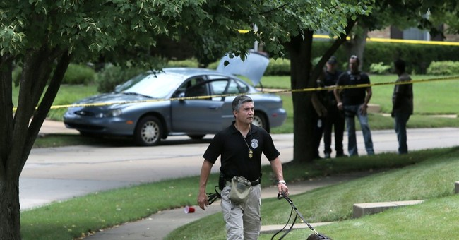 St. Louis-area officer shot in traffic stop; man charged