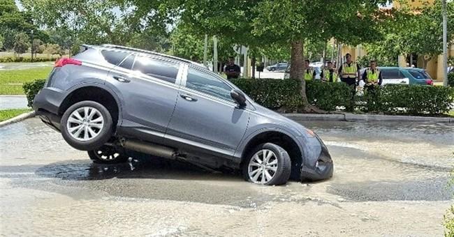 Sinkhole partially swallows car outside Florida McDonald's