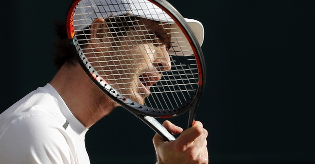 Fall, double-faults hurt Federer in Wimbledon loss to Raonic