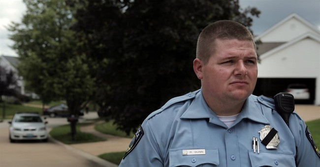 The Latest: Missouri officer is white; motive not yet known