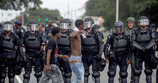 The Latest: More arrests Sunday in Baton Rouge
