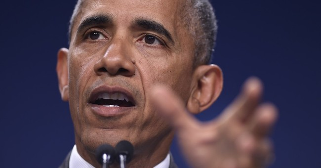 Obama asks Americans not to fear a return to a dark past