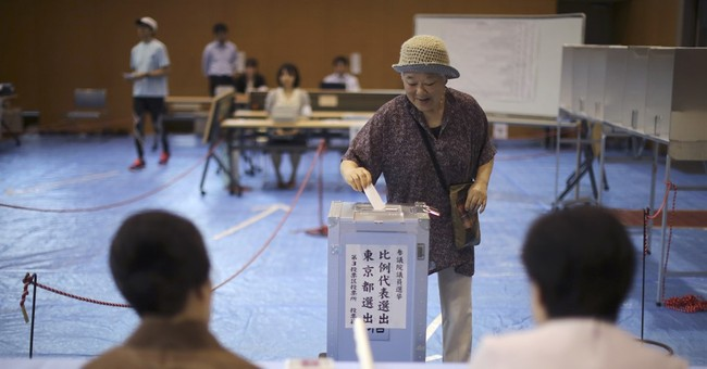 Japan coalition scores bigger-than-expected election win