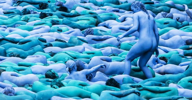 Thousands strip and paint themselves blue for UK art event