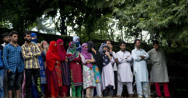15 die as protests roil Indian Kashmir after rebel's death