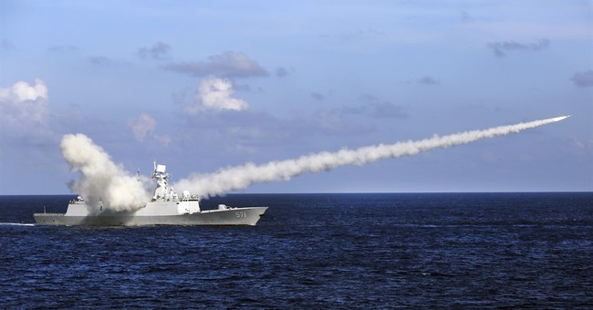 Chinese navy holds live-fire drills in South China Sea