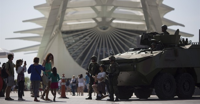 Armored cars, soldiers in camouflage secure Rio Olympics