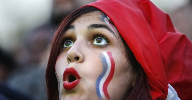 France, Portugal fans mingle amid tight security for final