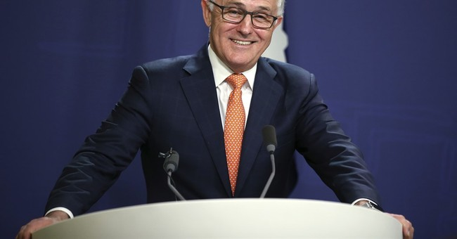 Australian leader claims election win, but questions remain