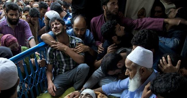 15 die as protests roil Indian Kashmir after rebel's death