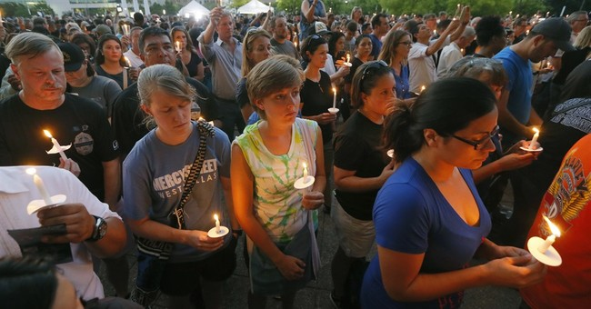 The Latest: Slain Dallas officers remembered at vigil
