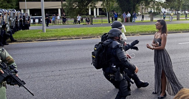 Striking photo captures woman's arrest at police protest