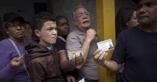 AP PHOTOS: Venezuelans living life on the line