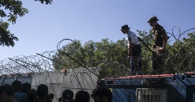 Hungarian officers beat migrants severely, rights group says